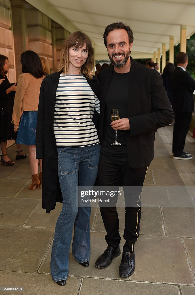 Anya Ziorova and Jose Neves attend the Creatures of the Wind Resort 2017 collection and runway show presented by Farfetch at Spencer House on June 29, 2016 in London, England.