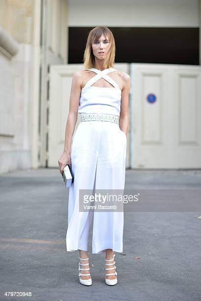 Anya Ziourova poses wearing a Sonia Rykiel dress after the Giambattista Valli show at the Grand Palais on July 6 2015 in Paris France