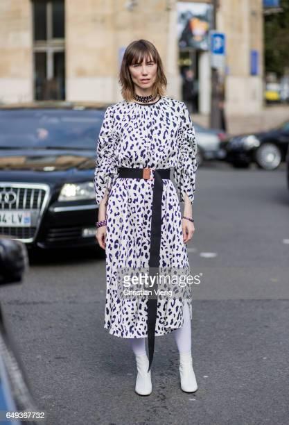 Anya Ziourova wearing a coat with zebra print outside Miu Miu on March 7 2017 in Paris France