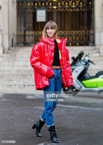 Anya Ziourova wearing a red AWAKE feather down jacket and blue denim jeans outside Stella McCartney during the Paris Fashion Week Womenswear...