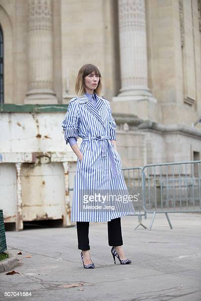 Anya Ziourova wears a Celine light blue and white striped belted dress/coat and Pierre Hardy heels at the Chanel couture show at Grand Palais on...