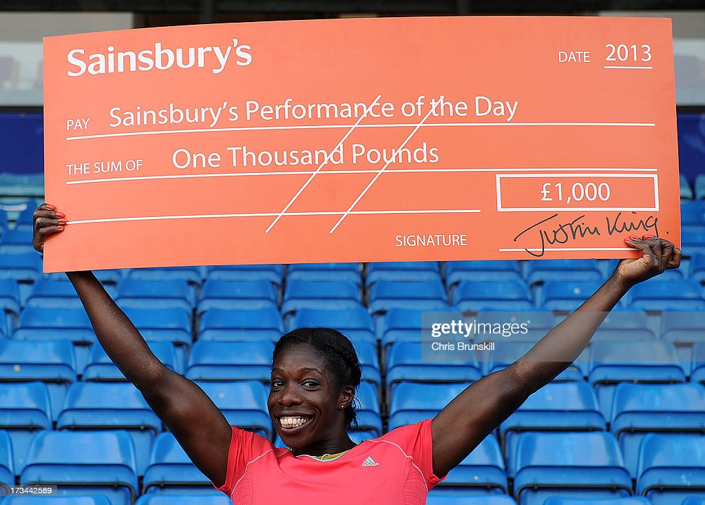 Anyika Onuora receives a cheque after the winning performance of the day following day three of the Sainsbury's British Championships, British Athletics World Trials and UK & England Championships at Alexander Palace on July 14, 2013 in Birmingham, England.
