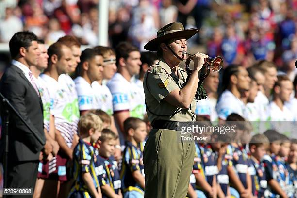 Anzac Day ceremony before the start of the game during the round eight NRL match between the Newcastle Knights and the Manly Sea Eagles at Hunter...