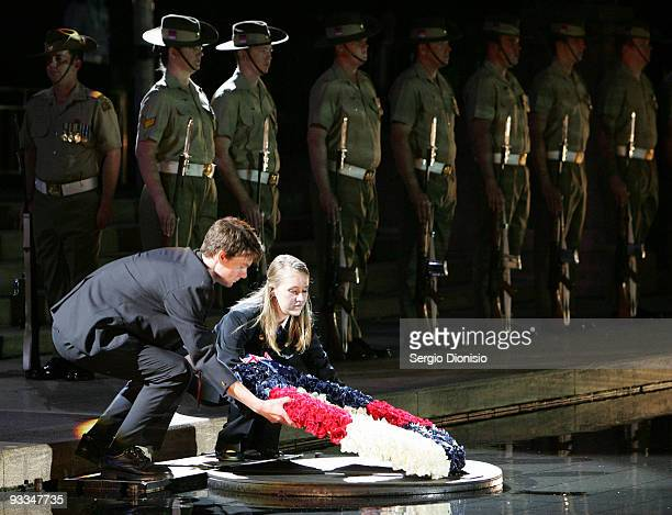 Anzac Memorial Scholars year 12 students Olivia Yeatman and John Drummond collect a wreath from the pool of reflection during the ANZAC Memorial 75th...