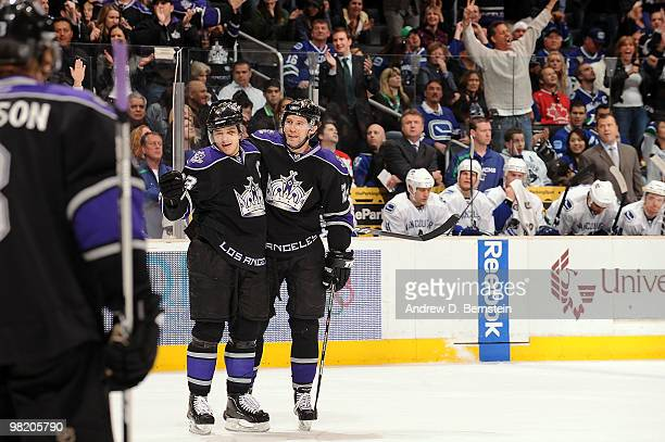 Anze Kopitar and Alexander Frolov of the Los Angeles Kings celebrate a first period goal against the Vancouver Canucks on April 1 2010 at Staples...