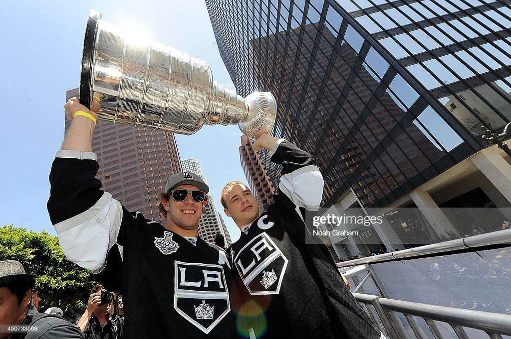 Anze Kopitar and Dustin Brown of the Los Angeles Kings celebrate with the Stanley Cup Trophy during the Los Angeles Kings victory parade and rally on...