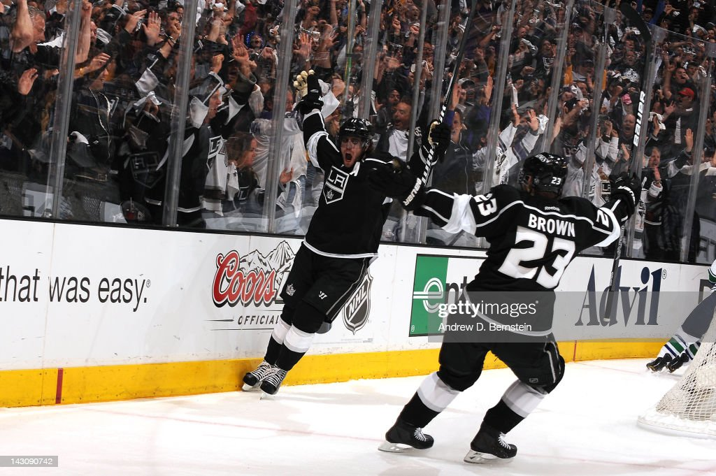 <a gi-track='captionPersonalityLinkClicked' href=/galleries/search?phrase=Anze+Kopitar&family=editorial&specificpeople=634911 ng-click='$event.stopPropagation()'>Anze Kopitar</a> #11 and Dustin Brown #23 of the Los Angeles Kings react after Kopitar's goal against the Vancouver Canucks in Game Four of the Western Conference Quarterfinals during the 2012 NHL Stanley Cup Playoffs at Staples Center on April 18, 2012 in Los Angeles, California.