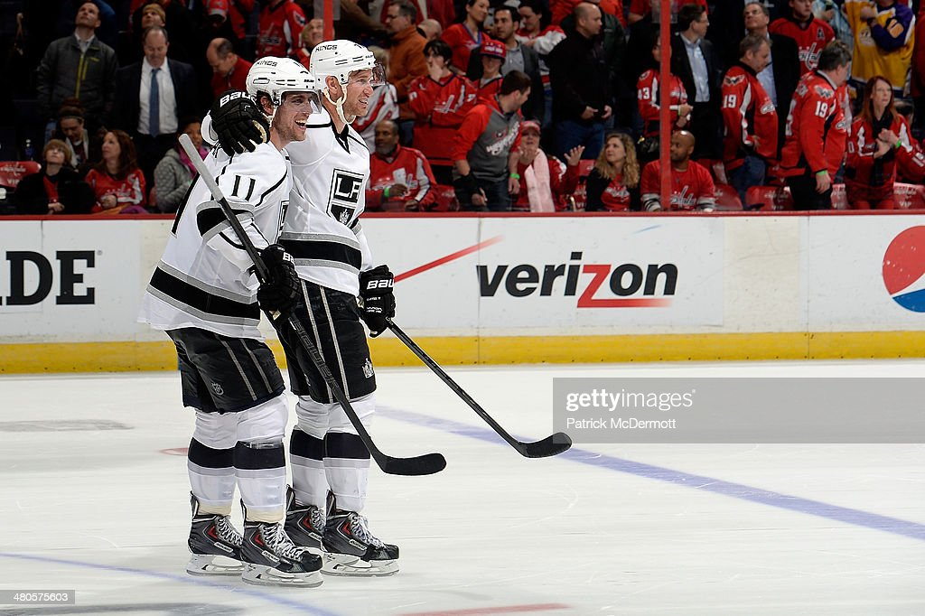 Anze Kopitar and Jeff Carter of the Los Angeles Kings celebrate after the Kings defeat the Washington Capitals 54 during an NHL game at Verizon...