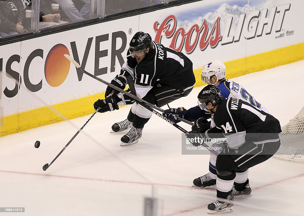 <a gi-track='captionPersonalityLinkClicked' href=/galleries/search?phrase=Anze+Kopitar&family=editorial&specificpeople=634911 ng-click='$event.stopPropagation()'>Anze Kopitar</a> #11 and Justin Williams #14 of the Los Angeles Kings vie for the puck with Alex Pietrangelo #27 of the St. Louis Blues in the third period of Game Six of the Western Conference Quarterfinals during the 2013 NHL Stanley Cup Playoffs at Staples Center on May 10, 2013 in Los Angeles, California. The Kings defeated the Blues 2-1 to win the series 4 games to 2 to advance to the Western Conference Semifinal.
