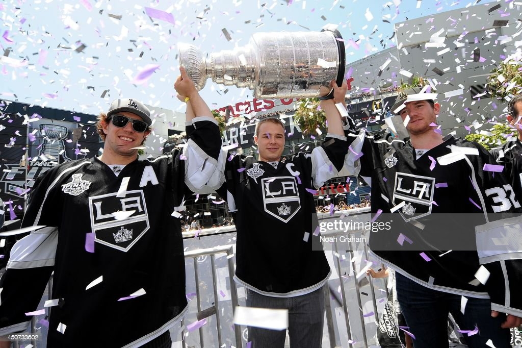 Anze Kopitar Dustin Brown and Jonathan Quick of the Los Angeles Kings celebrate during the Los Angeles Kings victory parade and rally on June 16 2014...