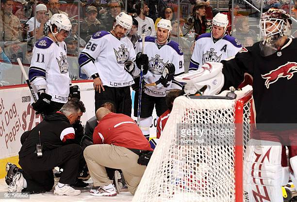 Anze Kopitar Michal Handzus Ryan Smyth and Matt Greene of the Los Angeles Kings look on with concern as teammate Justin Williams is treated by...