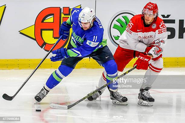 Anze Kopitar of Slovenia and Nicolas Oliver Lauridsen of Denmark battle for the puck during the IIHF World Championship group B match between...