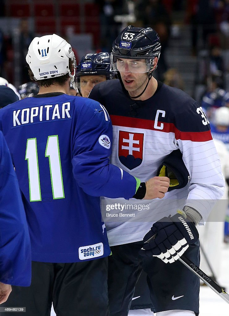 Anze Kopitar of Slovenia and Zdeno Chara of Slovakia shake hands after the Men's Ice Hockey Preliminary Round Group A game on day eight of the Sochi...