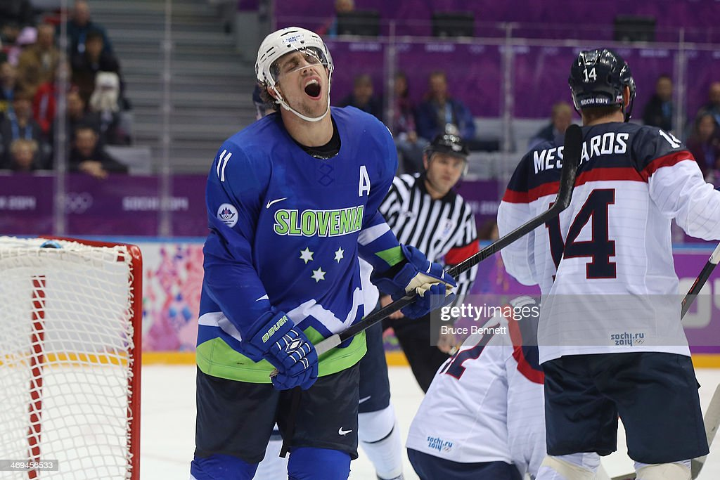 <a gi-track='captionPersonalityLinkClicked' href=/galleries/search?phrase=Anze+Kopitar&family=editorial&specificpeople=634911 ng-click='$event.stopPropagation()'>Anze Kopitar</a> #11 of Slovenia reacts after a play in the second period against Slovakia during the Men's Ice Hockey Preliminary Round Group A game on day eight of the Sochi 2014 Winter Olympics at Bolshoy Ice Dome on February 15, 2014 in Sochi, Russia.