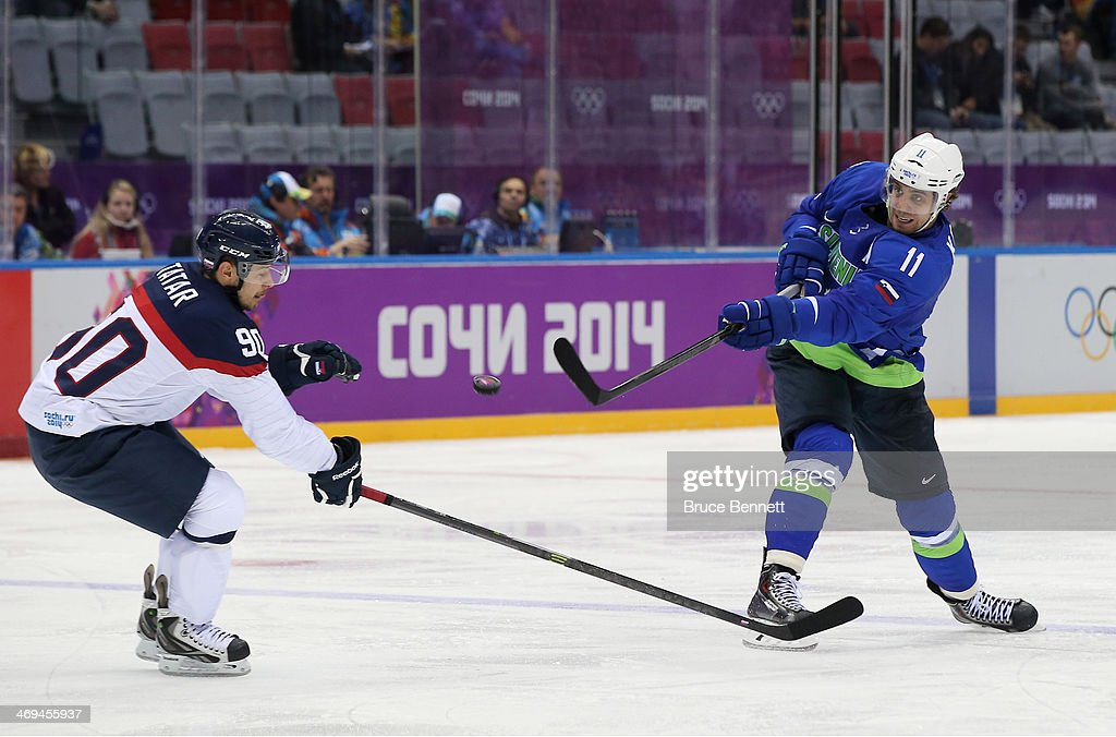 Anze Kopitar of Slovenia shoots against Tomas Tatar of Slovakia in the second period during the Men's Ice Hockey Preliminary Round Group A game on...