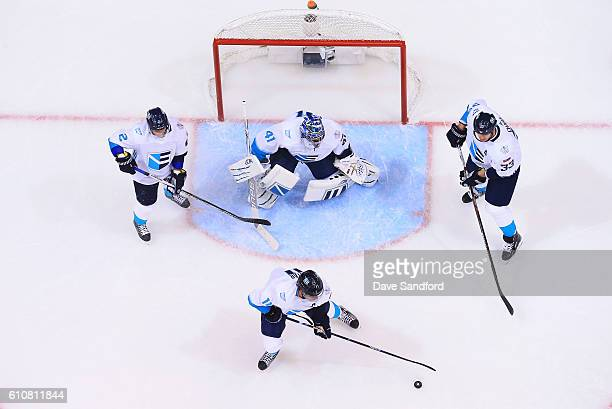 Anze Kopitar of Team Europe clears the puck from the crease as Jaroslav Halak of Team Europe Zdeno Chara of Team Europe and Andrej Sekera of Team...