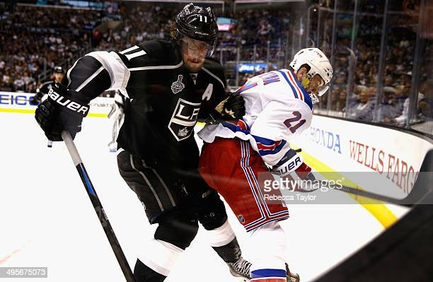 Anze Kopitar of the Los Angeles Kings and Derek Stepan of the New York Rangers battle for the puck during the second period of Game One of the 2014...