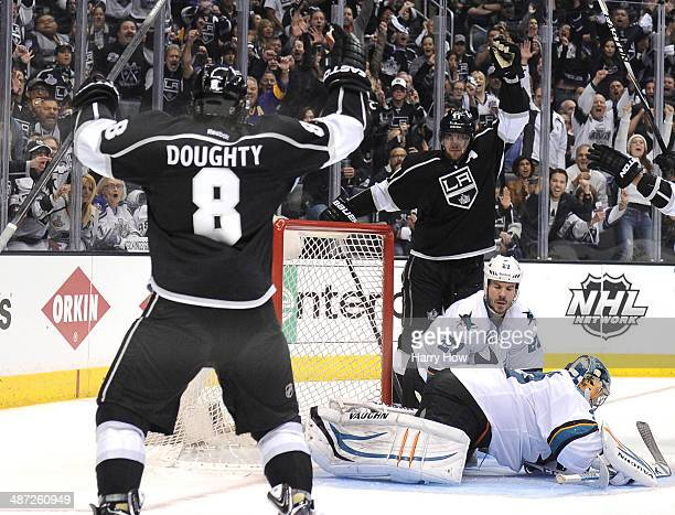 Anze Kopitar of the Los Angeles Kings and Drew Doughty celebrate a goal for a 41 lead in front of Alex Stalock and Scott Hannan of the San Jose...