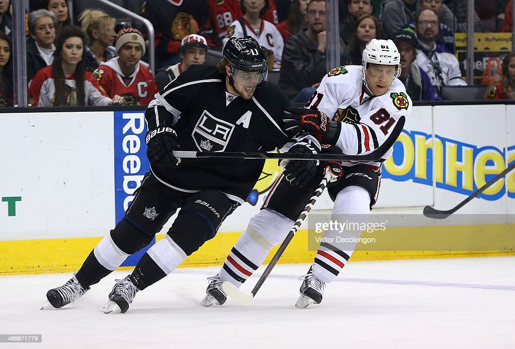 <a gi-track='captionPersonalityLinkClicked' href=/galleries/search?phrase=Anze+Kopitar&family=editorial&specificpeople=634911 ng-click='$event.stopPropagation()'>Anze Kopitar</a> #11 of the Los Angeles Kings and <a gi-track='captionPersonalityLinkClicked' href=/galleries/search?phrase=Marian+Hossa&family=editorial&specificpeople=202233 ng-click='$event.stopPropagation()'>Marian Hossa</a> #81 of the Chicago Blackhawks vie for position in the first period during the NHL game at Staples Center on February 3, 2014 in Los Angeles, California. The Blackhawks defeated the Kings 5-3.