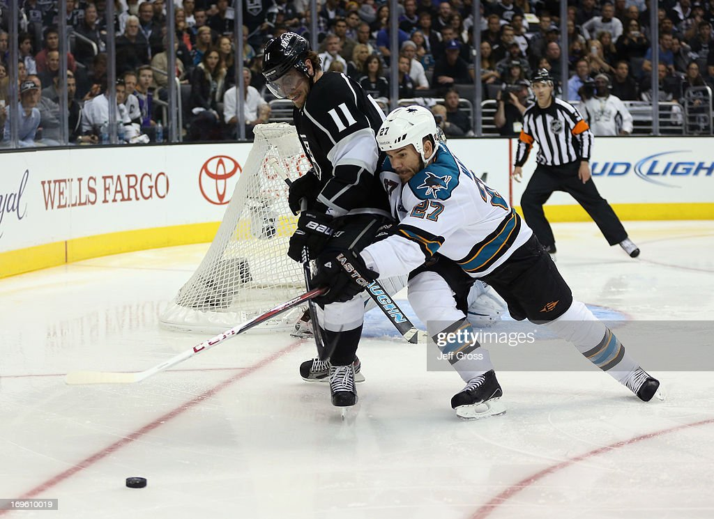 <a gi-track='captionPersonalityLinkClicked' href=/galleries/search?phrase=Anze+Kopitar&family=editorial&specificpeople=634911 ng-click='$event.stopPropagation()'>Anze Kopitar</a> #11 of the Los Angeles Kings and <a gi-track='captionPersonalityLinkClicked' href=/galleries/search?phrase=Scott+Hannan&family=editorial&specificpeople=203195 ng-click='$event.stopPropagation()'>Scott Hannan</a> #27 of the San Jose Sharks fight for the puck in the second period of Game Seven of the Western Conference Semifinals during the 2013 NHL Stanley Cup Playoffs at Staples Center on May 28, 2013 in Los Angeles, California. The Kings defeated the Sharks 2-1.