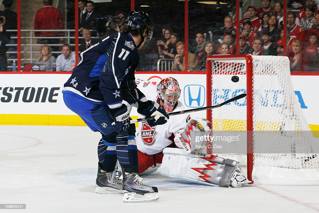 Anze Kopitar of the Los Angeles Kings and Team Lidstrom scores a goal on Cam Ward of the Carolina Hurricanes and Team Staal in the 58th NHL AllStar...