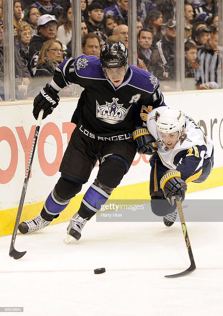 <a gi-track='captionPersonalityLinkClicked' href=/galleries/search?phrase=Anze+Kopitar&family=editorial&specificpeople=634911 ng-click='$event.stopPropagation()'>Anze Kopitar</a> #11 of the Los Angeles Kings and <a gi-track='captionPersonalityLinkClicked' href=/galleries/search?phrase=Thomas+Vanek&family=editorial&specificpeople=570606 ng-click='$event.stopPropagation()'>Thomas Vanek</a> #26 of the Buffalo Sabres fight for a puck during third period at the Staples Center on January 21, 2010 in Los Angeles, California. The Kings won 4-3 in an overtime shootout.