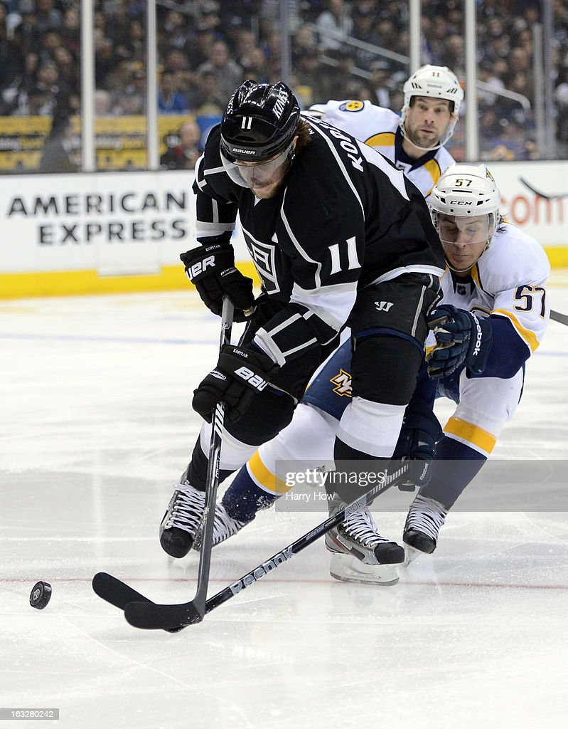 <a gi-track='captionPersonalityLinkClicked' href=/galleries/search?phrase=Anze+Kopitar&family=editorial&specificpeople=634911 ng-click='$event.stopPropagation()'>Anze Kopitar</a> #11 of the Los Angeles Kings breaks in past Gabriel Bourque #57 and <a gi-track='captionPersonalityLinkClicked' href=/galleries/search?phrase=David+Legwand&family=editorial&specificpeople=202553 ng-click='$event.stopPropagation()'>David Legwand</a> #11 of the Nashville Predators at Staples Center on March 4, 2013 in Los Angeles, California.