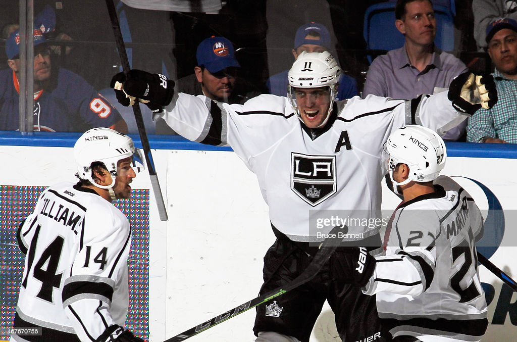 <a gi-track='captionPersonalityLinkClicked' href=/galleries/search?phrase=Anze+Kopitar&family=editorial&specificpeople=634911 ng-click='$event.stopPropagation()'>Anze Kopitar</a> #11 of the Los Angeles Kings celebrates his game winning goal at 15:37 of the third period against the New York Islanders at the Nassau Veterans Memorial Coliseum on March 26, 2015 in Uniondale, New York. The Kings defeated the Islanders 3-2.