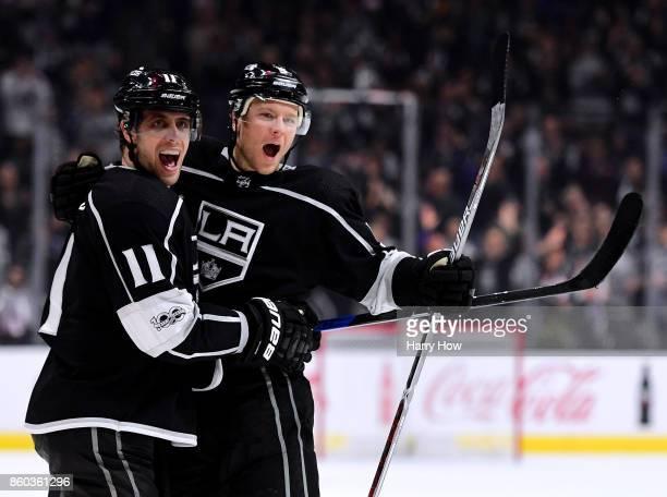 Anze Kopitar of the Los Angeles Kings celebrates his goal with Christian Folin to trail 21 to the Calgary Flames during the second period at Staples...