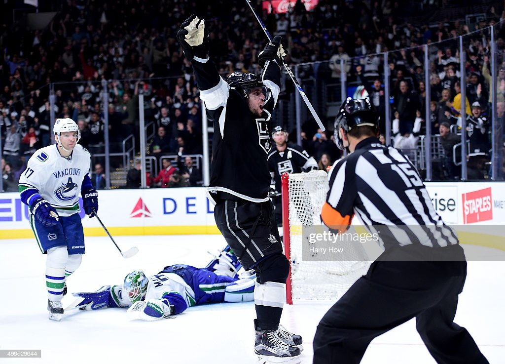 <a gi-track='captionPersonalityLinkClicked' href=/galleries/search?phrase=Anze+Kopitar&family=editorial&specificpeople=634911 ng-click='$event.stopPropagation()'>Anze Kopitar</a> #11 of the Los Angeles Kings celebrates his overtime goal in front of <a gi-track='captionPersonalityLinkClicked' href=/galleries/search?phrase=Radim+Vrbata&family=editorial&specificpeople=204716 ng-click='$event.stopPropagation()'>Radim Vrbata</a> #17 and <a gi-track='captionPersonalityLinkClicked' href=/galleries/search?phrase=Jacob+Markstrom&family=editorial&specificpeople=5370948 ng-click='$event.stopPropagation()'>Jacob Markstrom</a> #25 of the Vancouver Canucks 25 for a 2-1 win at Staples Center on December 1, 2015 in Los Angeles, California.