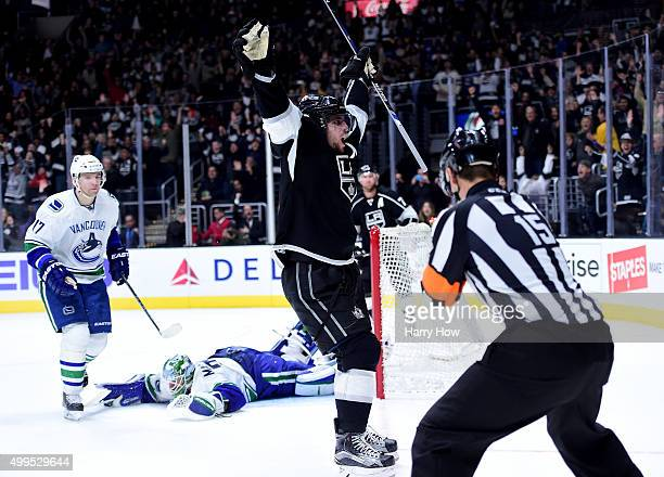 Anze Kopitar of the Los Angeles Kings celebrates his overtime goal in front of Radim Vrbata and Jacob Markstrom of the Vancouver Canucks 25 for a 21...