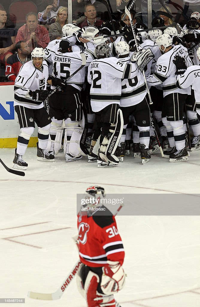 Anze Kopitar of the Los Angeles Kings celebrates with is teammates after scoring the game winning goal in overtime against the New Jersey Devils as...