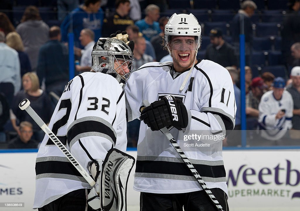Anze Kopitar of the Los Angeles Kings celebrates with teammate Jonathan Quick after winning 31 against the Tampa Bay Lightning at the Tampa Bay Times...