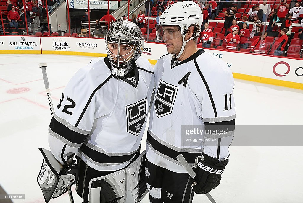<a gi-track='captionPersonalityLinkClicked' href=/galleries/search?phrase=Anze+Kopitar&family=editorial&specificpeople=634911 ng-click='$event.stopPropagation()'>Anze Kopitar</a> #11 of the Los Angeles Kings congratulates goaltender <a gi-track='captionPersonalityLinkClicked' href=/galleries/search?phrase=Jonathan+Quick&family=editorial&specificpeople=2271852 ng-click='$event.stopPropagation()'>Jonathan Quick</a> #32 on their shoot-out victory over the Carolina Hurricanes after an NHL game on October 11, 2013 at PNC Arena in Raleigh, North Carolina.