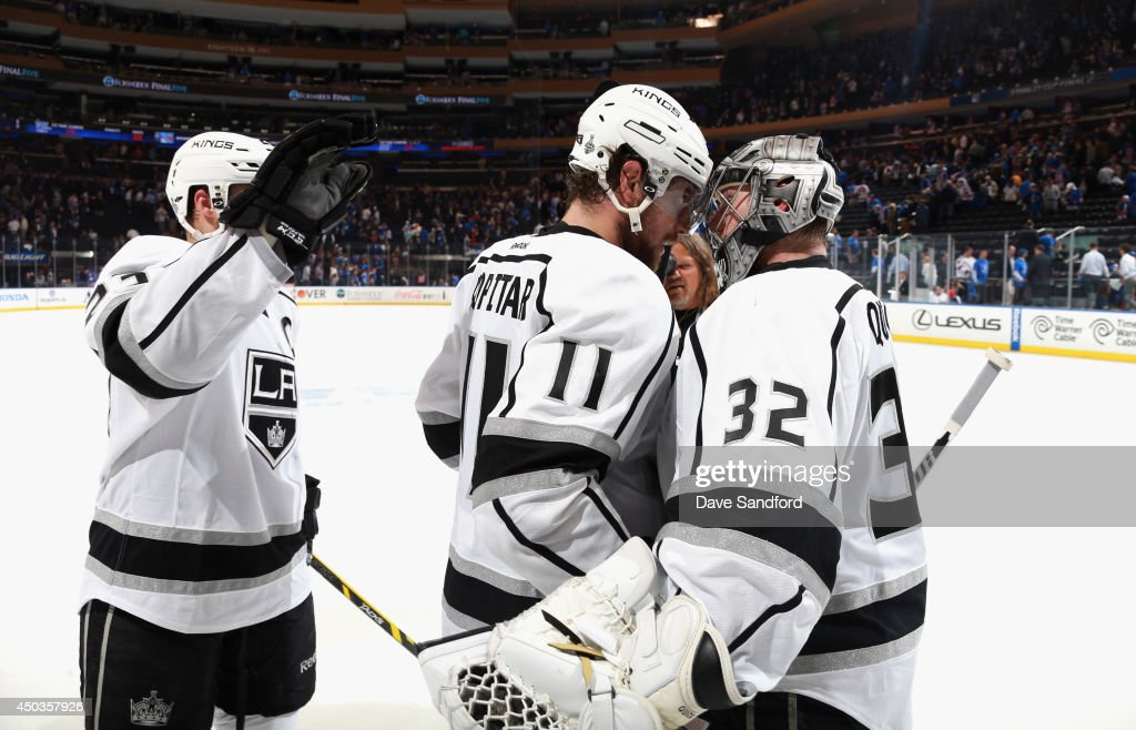 <a gi-track='captionPersonalityLinkClicked' href=/galleries/search?phrase=Anze+Kopitar&family=editorial&specificpeople=634911 ng-click='$event.stopPropagation()'>Anze Kopitar</a> #11 of the Los Angeles Kings congratulates goaltender <a gi-track='captionPersonalityLinkClicked' href=/galleries/search?phrase=Jonathan+Quick&family=editorial&specificpeople=2271852 ng-click='$event.stopPropagation()'>Jonathan Quick</a> #32 of the Los Angeles Kings after the Kings defeated the New York Rangers 3-0 in Game Three of the 2014 Stanley Cup Final at Madison Square Garden on June 9, 2014 in New York City.