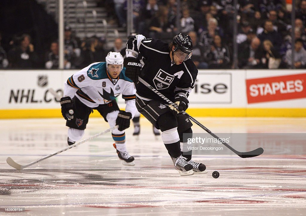 <a gi-track='captionPersonalityLinkClicked' href=/galleries/search?phrase=Anze+Kopitar&family=editorial&specificpeople=634911 ng-click='$event.stopPropagation()'>Anze Kopitar</a> #11 of the Los Angeles Kings controls the puck in the neutral zone as <a gi-track='captionPersonalityLinkClicked' href=/galleries/search?phrase=Joe+Pavelski&family=editorial&specificpeople=687042 ng-click='$event.stopPropagation()'>Joe Pavelski</a> #8 of the San Jose Sharks pursues the play during the NHL game at Staples Center on March 16, 2013 in Los Angeles, California. The Kings defeated the Sharks 5-2.