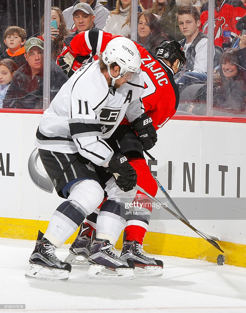 <a gi-track='captionPersonalityLinkClicked' href=/galleries/search?phrase=Anze+Kopitar&family=editorial&specificpeople=634911 ng-click='$event.stopPropagation()'>Anze Kopitar</a> #11 of the Los Angeles Kings defends against <a gi-track='captionPersonalityLinkClicked' href=/galleries/search?phrase=Travis+Zajac&family=editorial&specificpeople=864182 ng-click='$event.stopPropagation()'>Travis Zajac</a> #19 of the New Jersey Devils during the second period at the Prudential Center on February 14, 2016 in Newark, New Jersey.