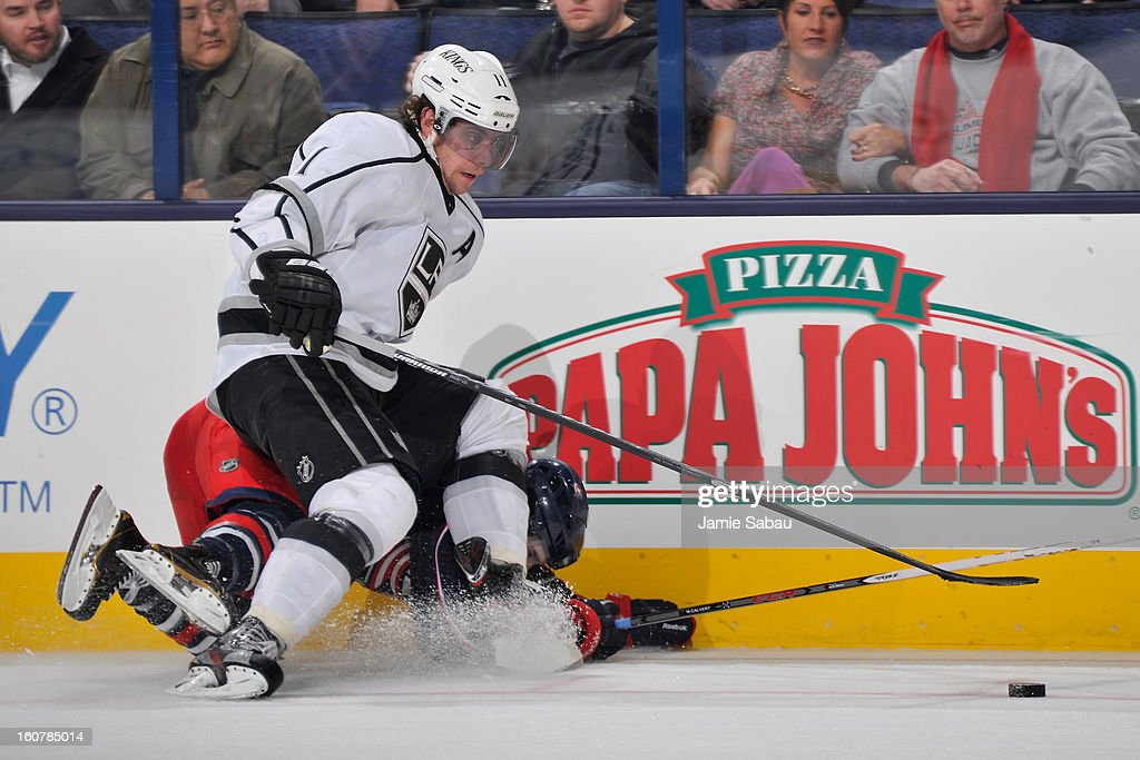 <a gi-track='captionPersonalityLinkClicked' href=/galleries/search?phrase=Anze+Kopitar&family=editorial&specificpeople=634911 ng-click='$event.stopPropagation()'>Anze Kopitar</a> #11 of the Los Angeles Kings falls on top of Matt Calvert #11 of the Columbus Blue Jackets in the third period while chasing after a loose puck on February 5, 2013 at Nationwide Arena in Columbus, Ohio. Los Angeles defeated Columbus 4-2.