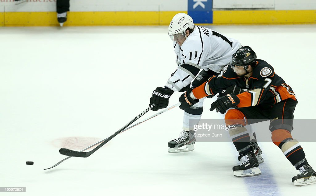 <a gi-track='captionPersonalityLinkClicked' href=/galleries/search?phrase=Anze+Kopitar&family=editorial&specificpeople=634911 ng-click='$event.stopPropagation()'>Anze Kopitar</a> #11 of the Los Angeles Kings fights for the puck with <a gi-track='captionPersonalityLinkClicked' href=/galleries/search?phrase=Andrew+Cogliano&family=editorial&specificpeople=869296 ng-click='$event.stopPropagation()'>Andrew Cogliano</a> #7 of the Anaheim Ducks at Honda Center on February 2, 2013 in Anaheim, California. The Ducks won 7-4.