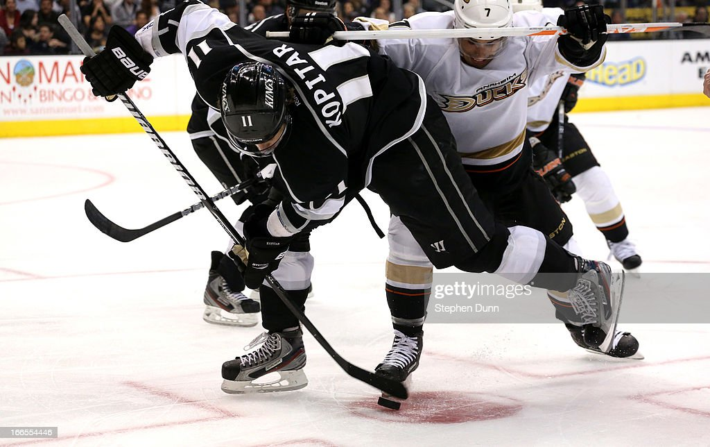 <a gi-track='captionPersonalityLinkClicked' href=/galleries/search?phrase=Anze+Kopitar&family=editorial&specificpeople=634911 ng-click='$event.stopPropagation()'>Anze Kopitar</a> #11 of the Los Angeles Kings fights for the puck with <a gi-track='captionPersonalityLinkClicked' href=/galleries/search?phrase=Andrew+Cogliano&family=editorial&specificpeople=869296 ng-click='$event.stopPropagation()'>Andrew Cogliano</a> #7 of the Anaheim Ducks at Staples Center on April 13, 2013 in Los Angeles, California. The Kings won 2-1.