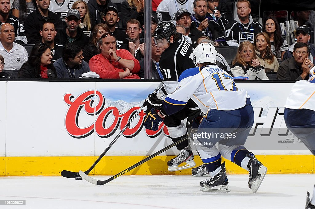 <a gi-track='captionPersonalityLinkClicked' href=/galleries/search?phrase=Anze+Kopitar&family=editorial&specificpeople=634911 ng-click='$event.stopPropagation()'>Anze Kopitar</a> #11 of the Los Angeles Kings handles the puck against Vladamir Sobotka #17 of the St. Louis Blues in Game Four of the Western Conference Quarterfinals during the 2013 NHL Stanley Cup Playoffs at Staples Center on May 6, 2013 in Los Angeles, California.