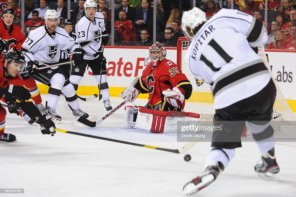 Anze Kopitar #11 of the Los Angeles Kings has his shot deflected by Blake Comeau #17 during an NHL game at Scotiabank Saddledome on February 20, 2013 in Calgary, Alberta, Canada.