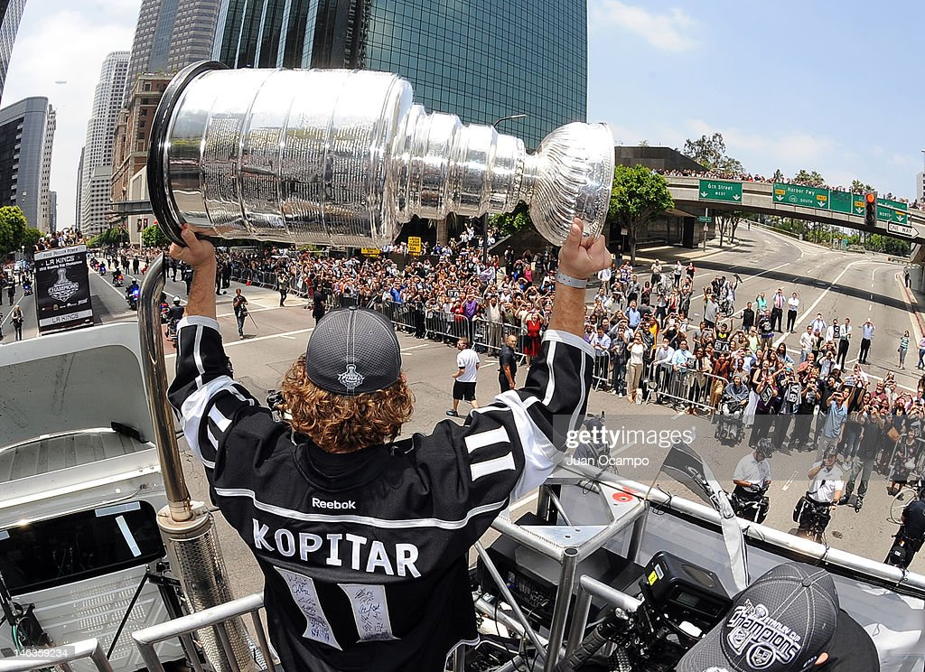 <a gi-track='captionPersonalityLinkClicked' href=/galleries/search?phrase=Anze+Kopitar&family=editorial&specificpeople=634911 ng-click='$event.stopPropagation()'>Anze Kopitar</a> #11 of the Los Angeles Kings holds the Stanley Cup during the Los Angeles Kings Parade and Rally on June 14, 2012 at Staples Center in Los Angeles, California.