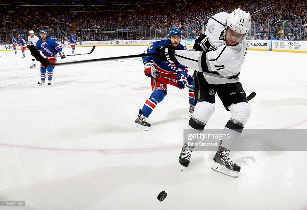 Anze Kopitar of the Los Angeles Kings is chased by Derick Brassard of the New York Rangers in the first period of Game Three of the 2014 Stanley Cup...