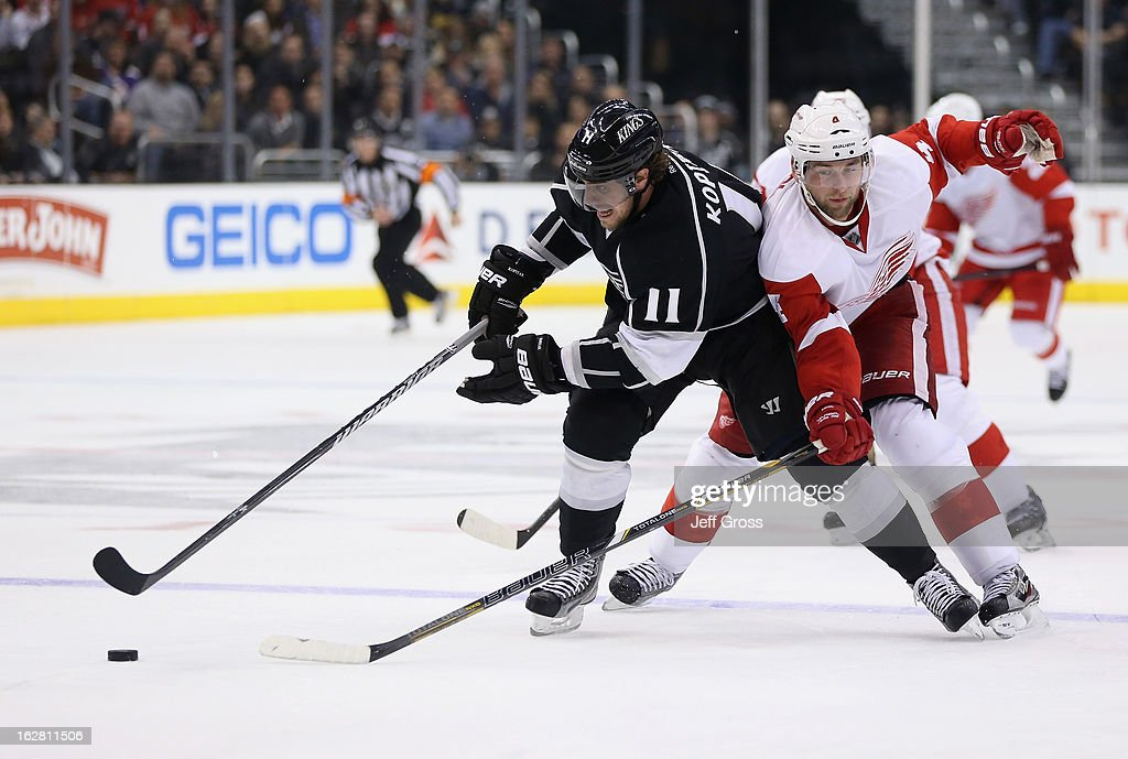 <a gi-track='captionPersonalityLinkClicked' href=/galleries/search?phrase=Anze+Kopitar&family=editorial&specificpeople=634911 ng-click='$event.stopPropagation()'>Anze Kopitar</a> #11 of the Los Angeles Kings is pursued by <a gi-track='captionPersonalityLinkClicked' href=/galleries/search?phrase=Jakub+Kindl&family=editorial&specificpeople=716743 ng-click='$event.stopPropagation()'>Jakub Kindl</a> #4 of the Detroit Red Wings for the puck in the second period at Staples Center on February 27, 2013 in Los Angeles, California. The Kings defeated the Red Wings 2-1.