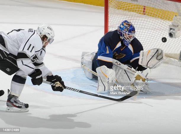 Anze Kopitar of the Los Angeles Kings lifts the puck past goalie Brian Elliott of the St Louis Blues in Game Two of the Western Conference Semifinals...