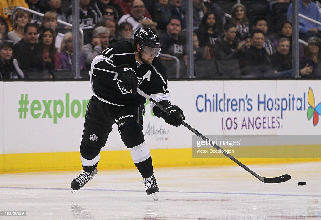 <a gi-track='captionPersonalityLinkClicked' href=/galleries/search?phrase=Anze+Kopitar&family=editorial&specificpeople=634911 ng-click='$event.stopPropagation()'>Anze Kopitar</a> #11 of the Los Angeles Kings makes a pass in the neutral zone during the NHL game against the Nashville Predators at Staples Center on November 2, 2013 in Los Angeles, California. The Predators defeated the Kings 4-3.