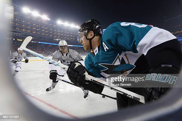 Anze Kopitar of the Los Angeles Kings moves in on Joe Pavelski of the San Jose Sharks during the 2015 Coors Light NHL Stadium Series game at Levi's...