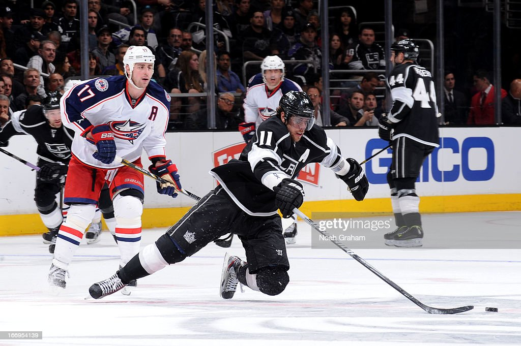 <a gi-track='captionPersonalityLinkClicked' href=/galleries/search?phrase=Anze+Kopitar&family=editorial&specificpeople=634911 ng-click='$event.stopPropagation()'>Anze Kopitar</a> #11 of the Los Angeles Kings reaches for the puck against the Columbus Blue Jackets at Staples Center on April 18, 2013 in Los Angeles, California.