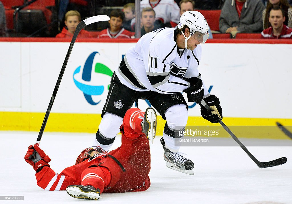 <a gi-track='captionPersonalityLinkClicked' href=/galleries/search?phrase=Anze+Kopitar&family=editorial&specificpeople=634911 ng-click='$event.stopPropagation()'>Anze Kopitar</a> #11 of the Los Angeles Kings runs over <a gi-track='captionPersonalityLinkClicked' href=/galleries/search?phrase=Nathan+Gerbe&family=editorial&specificpeople=697084 ng-click='$event.stopPropagation()'>Nathan Gerbe</a> #14 of the Carolina Hurricanes during play at PNC Arena on October 11, 2013 in Raleigh, North Carolina.